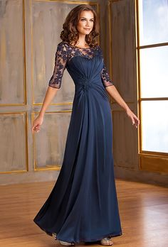 Jade by Jasmine. A dress that will set you apart from the rest for your next special occasion. This stretch illusion dress has an elegant scoop neckline and an A-line skirt. Details on the dress includes beautiful lace detail on the bodice and ruching on the neckline.