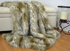 "Stunning wild cat faux fur blanket throw. This blanket is made from the finest quality faux fur and backed with the softest of fabrics, minky cuddle fabric. The blanket is a wild cat or leopard pattern in ivory and shades of caramel. The fur fibers are about 2 long. The backing is a silky soft minky in either ivory or caramel, you choose! The blanket is over sized, measuring approximately 60"" x 72"", big enough for 2 to snuggle under. I hand pick each of my faux fur fabric based on both…"