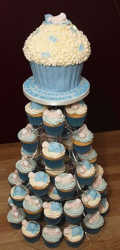 baby boy shower cupcake towers | ... Handmade Fondant Baby Topper With Matching Baby Boy Cupcakes Tower