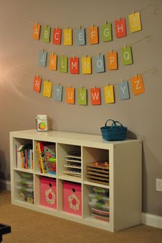 "Playroom - Ikea Expedit shelf and ABC alphabet banner. Playroom – Ikea Expedit shelf and ABC alphabet banner. Cards are ""My Favorite Things Flash Card Ikea Expedit Shelf, Ikea Regal Expedit, Playroom Decor, Kids Decor, Home Decor, Playroom Ideas, Playroom Storage, Decor Room, Baby Decor"