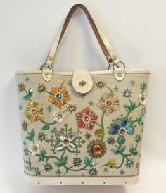 Just look at the pictures and see how beautiful this handbag is. The front of this handbag is covered with sparkling jeweled flowers. This bag has leather trim and dual leather straps. The top closes with a leather strap with a slip over & twist clasp. | eBay!
