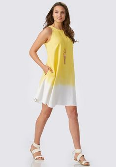 Breeze through the season in style with this stunning swing dress. #versona #shopversona #swingdress #ombre #yellow