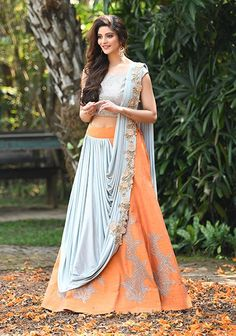 beautiful coral lehenga with powder blue dupatta drape. Click on image to see Kolkata Bridal Lehenga Stores. #Frugal2Fab