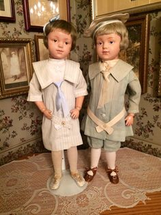 "Rare ""smiling"" 21/308 girl and ""smiling"" 21/405 boy, both made only in 1912. Girl is wearing all Schoenhut factory original clothing except for guimpe and silk tie."