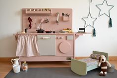 Bespoke wooden toy kitchen with laundry, iron, phone. #woodentoy #woodenkitchen #macarenabilbao