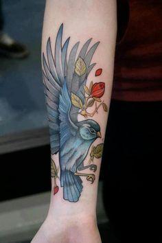 Blue bird tattoos on the arm