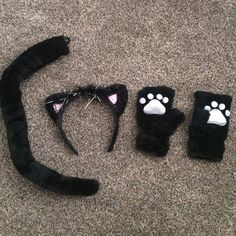 Cute Cat Halloween Costume Only worn once. Includes the black tail, black silver and pink cat ears, and the black and silver paws. One of the paws has a mark on it (pictured). One cat ear has a loose thread (also pictured). Great condition, super cute. PRICE IS FIRM unless bundled. No trades. Bundle and save! :) Accessories