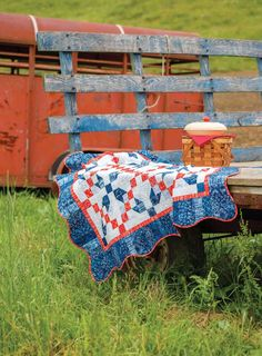 Pre-cut strips in red and blue batiks make Summertime Blues, by Darlene Zimmerman, an ideal summer quilt. Doesn't it just sing summer? Sew this one up for a picnic in the park! The curvy edge dresses up the scrappy border and adds an element of fun.