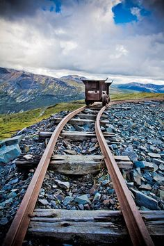 Narrow gauge train tracks that were used in gold and silver mines of the west, note the ore car, it was hand pushed