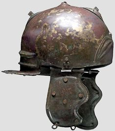Roman early Weisenau Type Helmet, from the Axel Guttmann collection, now in a US private collection. Unusual are the eye brows and shape, showing Celtic (?) influence.