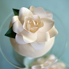 Make this gorgeous paper gardenia for a Mother's Day gift topper, to decorate a cake or for a pretty bouquet. This step-by-step tutorial is too easy to miss