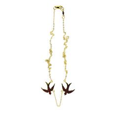 blackbird and the snow  inspired by Victorian charms found in antique markets collected over the  years, designer Marie-Juliette Bird uses recycled metals and ethically  sourced stones to handcraft her pieces  two 14k white gold flying swallows with black rhodium plate set with 11  rubies eac