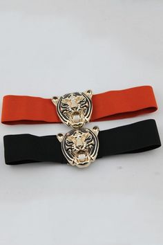 Belt made of polyester, featuring elastic design, tiger head embellishment to front, wide design.$13