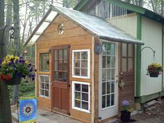 """Landscaping has begun around my """"reclaimed"""" materials garden shed!  Love the doors, windows & antique touches!"""
