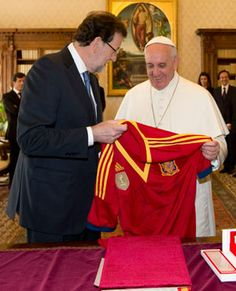 Pope Francis adds a Spain Confederations Cup shirt to his collection.