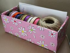 shoebox wrapped in gift wrap for craft supplies or other things
