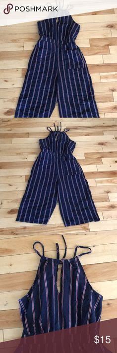 Striped jumpsuit -navy blue jumpsuit that is red and white striped(perfect for 4th of july) -has a tie in the bag and little open cut in the front that makes it very flattering! -only worn once  -sinched waist  brand is Universal Thread  measurements:  from the bottom of straps to middle is about 14 inches from the middle to the bottom of the pant leg is about 28 inches full length from top to bottom is about 42 1/2 inches width of pant leg is about 10 1/2 inches Pants Jumpsuits & Rompers