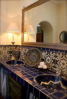 This is the master bathroom in our second home here in San Miguel de Allende. The two lamps I had wired and made in Portland...the cord drops down through a hole in the tile and can be turned on with the wall switch.lamps,