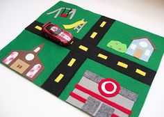 Make some road play mats with frequented places (target, Starbucks, aquarium, etc) they can play in the car, but at hotel they can lay them out next to each other to make a huge town!