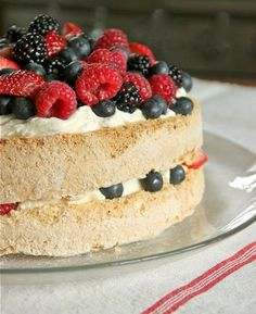 Pavlova Cake w/ Berries and Lemon CUrd Whipped Cream