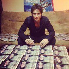 signing valentine's day card.