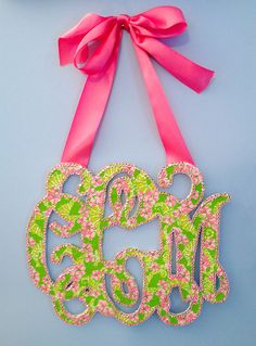 """DIY Monogram: draw or trace monogram on thin posterboard, cut out with Xacto knife, trace shape of monogram onto Lilly wrapping paper, cut out and modpodge paper onto monogram, use """"bling on a roll"""" rhinestones as border, add ribbon to hang."""