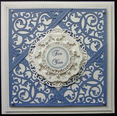 handmade card from PartiCraft (Participate In Craft) ... gorgeous die cuts from Spellbinders .... wedgewood blue and white ... filegre look ... like the way the corner cuts overlap to make a diamond shaped backing for the central layered medallion ... beautiful!