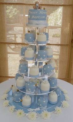 Baptism Cake with Cupcakes Bolo Pikachu, Mini Cakes, Cupcake Cakes, Christening Cake Boy, Baptism Cakes, Planet Cake, Baptism Party, Baptism Ideas, Boy Baptism