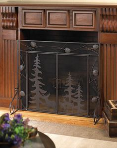"A wonderful woodland scene is yours to enjoy every day when you place this gorgeous iron screen in front of your fireplace. Detailed pine cones surround the outer trim, while the interior panels feature silhouettes of evergreens and forest creatures. Its the perfect way to frame the flickering flames inside your fireplace! Material(s): IRON METAL - SHEET METAL - MESH SHEET METAL, MESH METAL Dimensions: 38"" x 4.5"" x 31.2"""