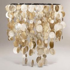 One of my favorite discoveries at WorldMarket.com: Capiz Hanging Pendant Lantern    Want it baaaad!!