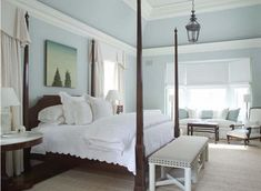Master Bedroom in soft cool blue and white with stunning tall four poster bed