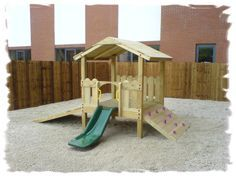 A small toddler climbing area/slide/house with additional play elements