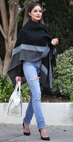 Bold and the beautiful: Model Olivia Culpo took cover under a large blanket wrap during a casual stroll on Monday in Los Angeles