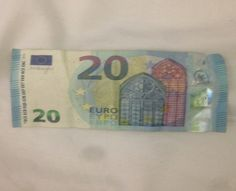 The front of the 20 euro bill features windows of the Gothic architectural style.  The windows are Gothic because of the pointed tops, a common characteristic of Gothic architecture.