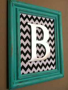 The Baeza Blog: Aqua Distressed Monogram Frame...Fabric or scrapbook paper for a background with a painted initial in an open frame.