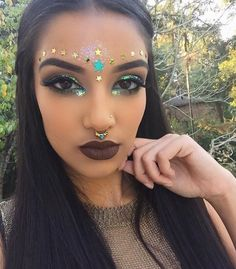 Gold and blue glitter make up by Rowi Singh