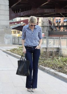 Navy Gingham shirt with flare jeans and black bag - Winter outfit inspiration