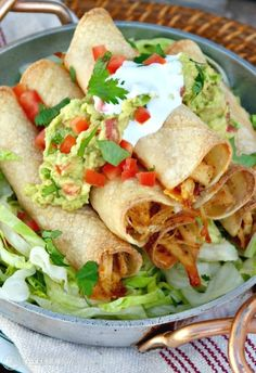Baked Chicken Taquitos filled with seasoned shredded chicken and cheese! Add your favorite toppings and enjoy at your next fiesta!