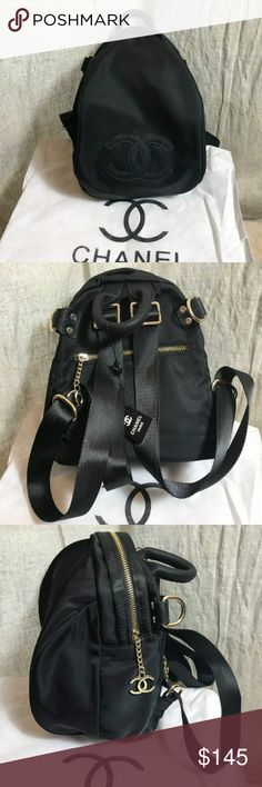 """Chanel vip gift bag backpack cross body bag Authentic 2017 Chanel vip backpack cross body bag. Nylon. Black. Measure:H12 x W8 x D7"""".Brand new with original Chanel packaging bag and dust bag. It is a vip gift form a Chanel store in Asia.with extra strap for cross body. Great price. Great quality . this is a better quality version. Not the $80.00 one CHANEL Bags Backpacks"""