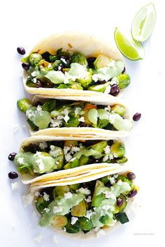 Brussels Sprouts Tacos -- quick and easy to make, and made with a heavenly creamy avocado sauce! | gimmesomeoven.com