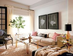 A feminine and luxurious living space with patterned pillows, indoor plant, and faux fur throw