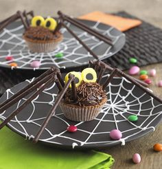 Make your life even easier by just decorating store-bought chocolate cupcakes. #Halloween #Recipe #Spider