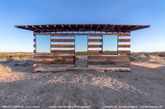 """Lucid Stead is an architectural installation by artist Phillip K. Smith III that takes an existing structure in the deserts of Joshua Tree, California and revitalizes it with mirrors, LED lights, and custom built technology to accentuate the beauty of the bare landscape. Aptly referred to as an """"architectural intervention,"""" the 70-year-old homesteader shack's weathered and worn stature is transformed into a remarkable vision that makes viewers question whether they are hallucinating."""