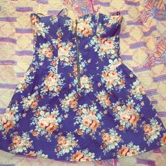 Floral strapless dress Navy blue floral strapless dress, size medium but need large bust to fill it out Romeo & Juliet Couture Dresses Strapless