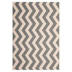 Loomed indoor/outdoor rug with a grey and beige chevron motif.  Product: RugConstruction Material: Polypropylene...