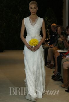 "Brides.com: Carolina Herrera - Spring 2014. ""Britt"" ivory silk chiffon and lace wrap gown with silk organza sash, Carolina Herrera"