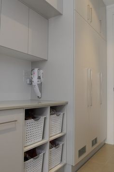 Utility Closet Design Ideas, Pictures, Remodel and Decor Laundry Nook, Laundry Baskets, Modern White Bathroom, Utility Closet, Dressing, Attic Storage, Laundry Room Design, Closet Designs, Bathroom Interior