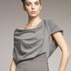 Donna Karan Cashmere Top Tunic Gray Medium NWT DOnna Karan Cashmere Silk Top Tunic Gray Medium NWT.  I have a pair of Donna Karan pants that go with the top, if u r interested.  They r gorgeous on. Donna Karan Sweaters Cowl & Turtlenecks
