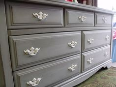 Grey dresser white handles:) its what to do with that old hideous out of date one;) love this idea.