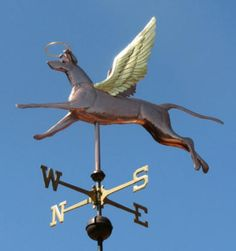 Angel Dog Weather Vane,  by West Coast Weather Vanes.  This Angel Dog  is portrayed as happy, frisky and bounding with energy.